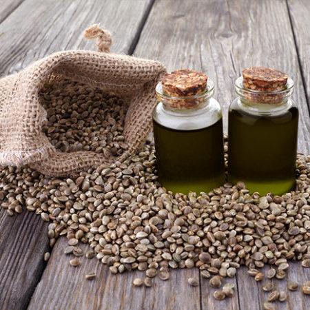 Bag of hemp seeds and hemp seed oil in bottles