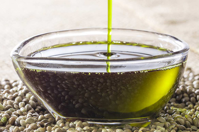 Hemp seed oil pouring